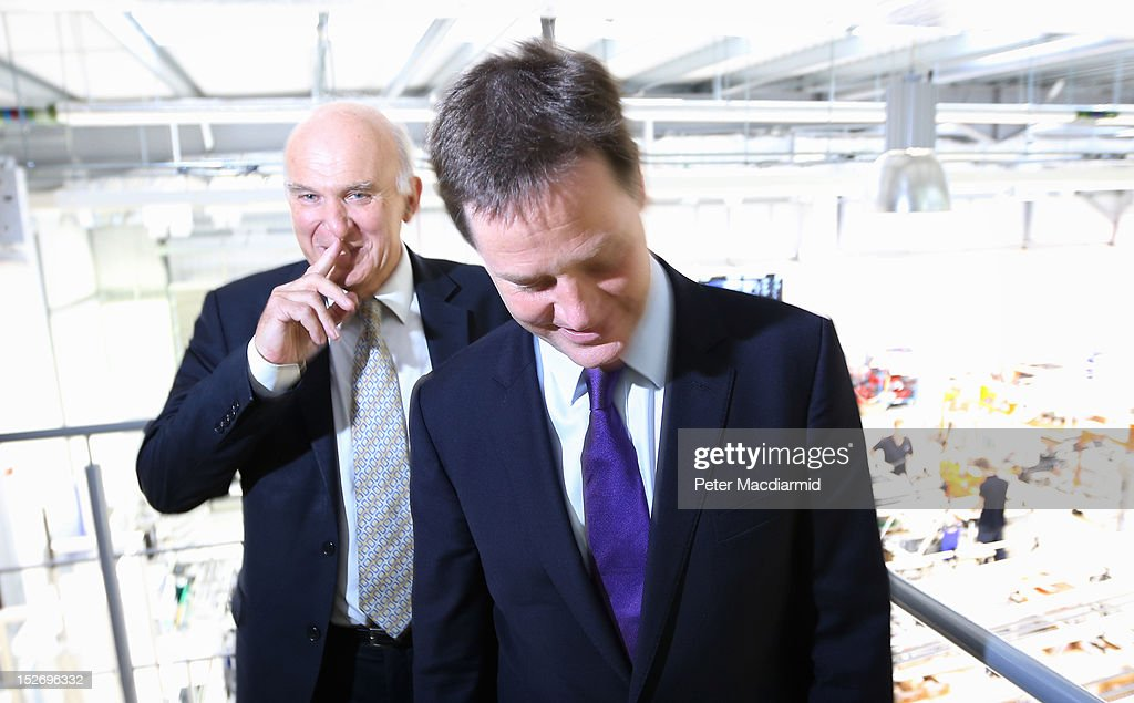 Deputy Prime Minister Nick Clegg (R) and Business Secretary Vince Cable pose for photographs during a visit to the Ricardo Engine Assembly plant on September 24, 2012 in Shoreham-by-Sea, England. Later the Business Secretary Vince Cable will announce a new bank to enable easier lending to businesses.