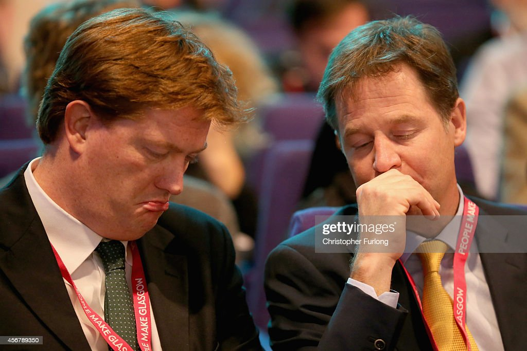 Deputy Prime Minister <a gi-track='captionPersonalityLinkClicked' href=/galleries/search?phrase=Nick+Clegg&family=editorial&specificpeople=579276 ng-click='$event.stopPropagation()'>Nick Clegg</a> and Chief Secretary to the Treasury <a gi-track='captionPersonalityLinkClicked' href=/galleries/search?phrase=Danny+Alexander+-+Politician&family=editorial&specificpeople=6897330 ng-click='$event.stopPropagation()'>Danny Alexander</a> chat in the auditorium on the fourth day of the Liberal Democrat Autumn conference at the SECC on October 7, 2014 in Glasgow, Scotland. Lib Dem Energy Secretary Ed Davey will later address delgates where he is expected to announce a U-turn on the partys stance on airport expansion.