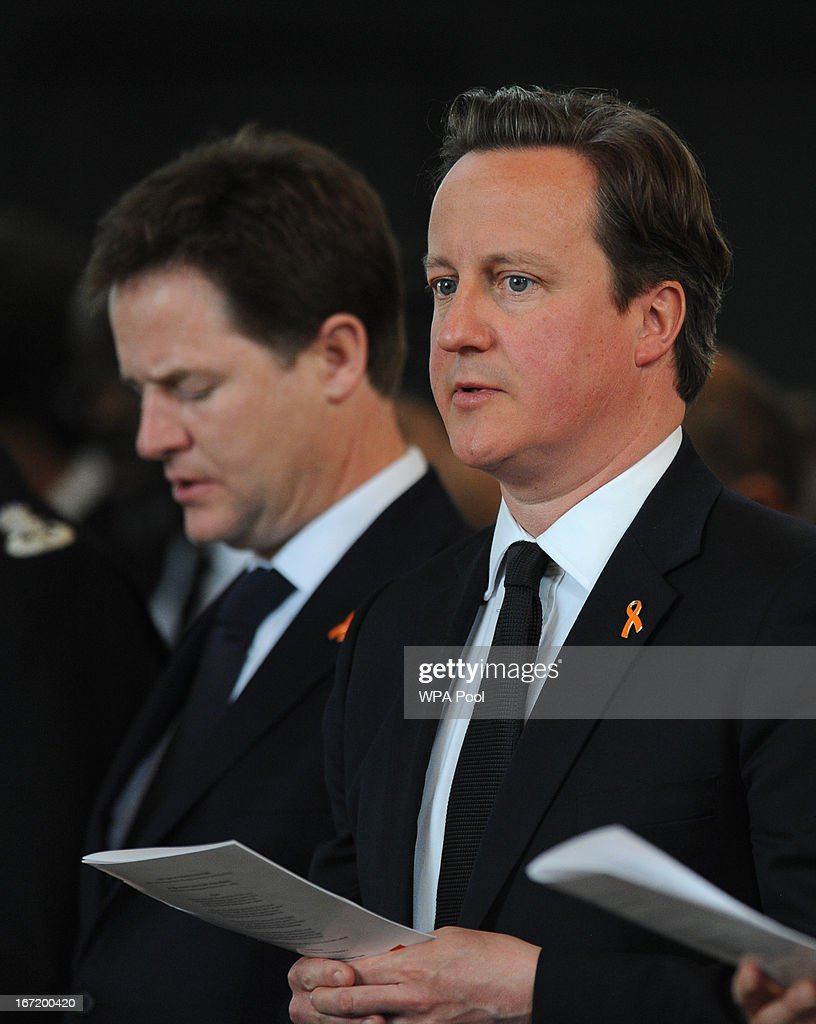 Deputy Prime Minister Nick Clegg and Prime Minister David Cameron (R) attend a memorial service for Stephen Lawrence at St Martin-in-the-Fields Church on April 22, 2013 in London, England. Stephen Lawrence, a black A-level student was stabbed to death at a bus stop twenty years ago by a gang of white youths in a racially motivated attack in Eltham, south-east London, on April 22, 1993. Two men, Gary Dobson and David Norris were found guilty of his murder in January 2012.