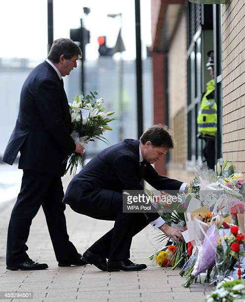 Deputy Prime Minister Nick Clegg and Scottish Secretary Alistair Carmichael lay flowers near to The Clutha bar in Stockwell Street where a police...