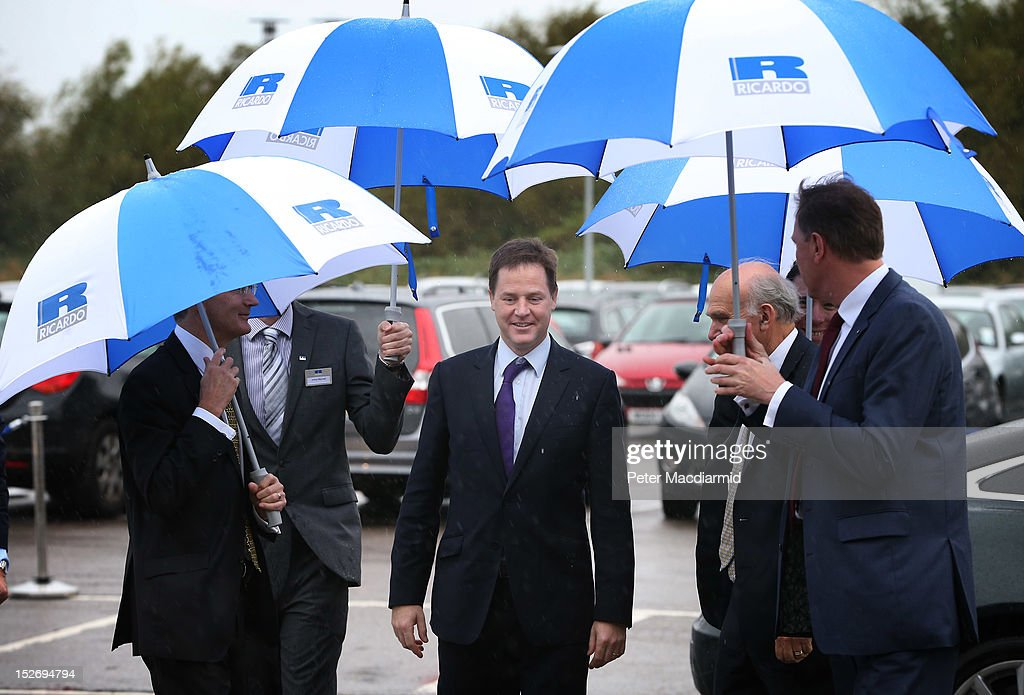 Deputy Prime Minister Nick Clegg (C) arrives at The Ricardo Engine Assembly plant on September 24, 2012 in Shoreham-by-Sea, England. Later the Business Secretary Vince Cable will announce a new bank to enable easier lending to businesses.
