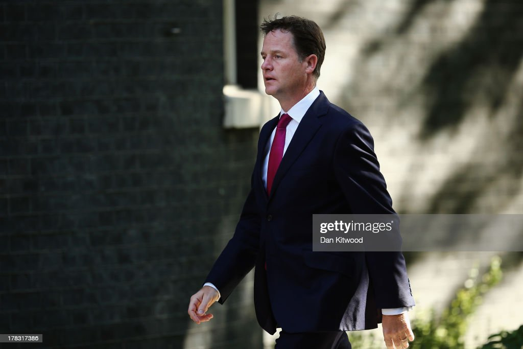 Deputy Prime Minister <a gi-track='captionPersonalityLinkClicked' href=/galleries/search?phrase=Nick+Clegg&family=editorial&specificpeople=579276 ng-click='$event.stopPropagation()'>Nick Clegg</a> arrives in Downing Street on August 29, 2013 in London, England. Prime Minister David Cameron has recalled Parliament to debate the UK's response to a suspected chemical weapon attack in Syria.