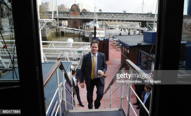Deputy Prime Minister Nick Clegg arrives to cohost his weekly phone in radio show with LBC's Nick Ferrari on the moored boat the Tattersall Castle on...