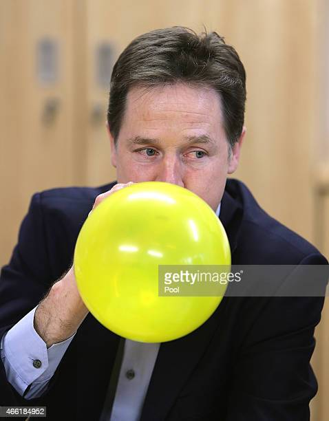 Deputy Prime Minister Nick Clegg blows up a balloon as he takes part in a mental health session during a visit to the Clock View Hospital in Walton...