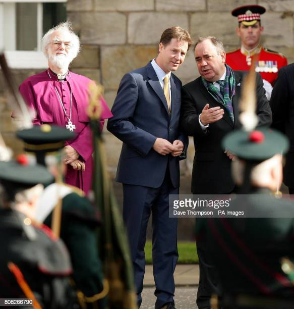 Deputy Prime Minister Nick Clegg First Minister of Scotland Alex Salmond and the Archbishop of Canterbury watch as Pope Benedict XVI leaves the...