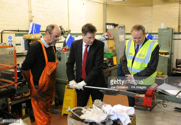 Deputy Prime Minister Nick Clegg helps to calibrate a torque wrench with service support fitter Tony Courtney and managing director Peter Coates...