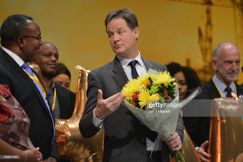 Deputy Prime Minister <a gi-track='captionPersonalityLinkClicked' href=/galleries/search?phrase=Nick+Clegg&family=editorial&specificpeople=579276 ng-click='$event.stopPropagation()'>Nick Clegg</a>, holds flowers during the Citizens UK presentation at the Liberal Democrat conference on September 23, 2012 in Brighton, England. Liberal Democrats leader <a gi-track='captionPersonalityLinkClicked' href=/galleries/search?phrase=Nick+Clegg&family=editorial&specificpeople=579276 ng-click='$event.stopPropagation()'>Nick Clegg</a> is urging party supporters not to 'squabble' with the Conservatives while insisting the Tories maintain the bargain of the coalition government.