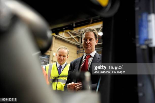 Deputy Prime Minister Nick Clegg inspects a bus engine with managing director Peter Coates during a visit to National Express West Midlands...