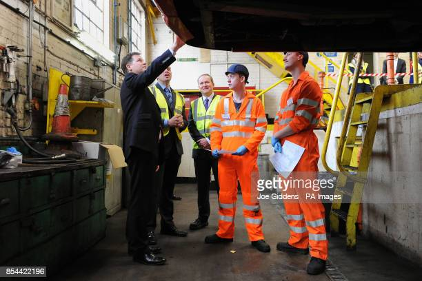 Deputy Prime Minister Nick Clegg inspects the work of apprentices Dylan Young and Jamie Atkinson during a visit to National Express West Midlands...