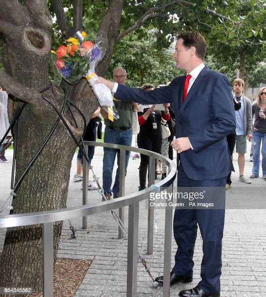 Deputy Prime Minister Nick Clegg lays flowers during a visit to the World Trade Center 9/11 Memorial and the new 1 World Trade Center building Lower...