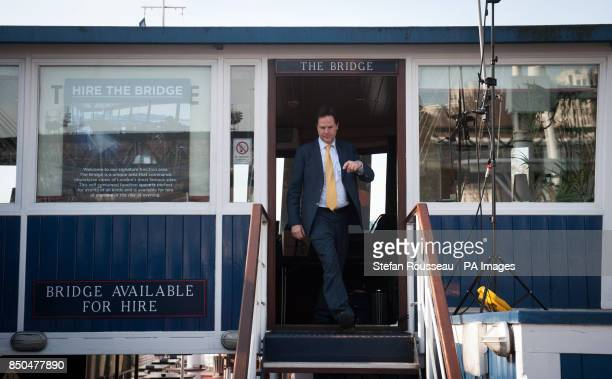 Deputy Prime Minister Nick Clegg leaves after cohosting his weekly phone in radio show with LBC's Nick Ferrari on the moored boat the Tattersall...