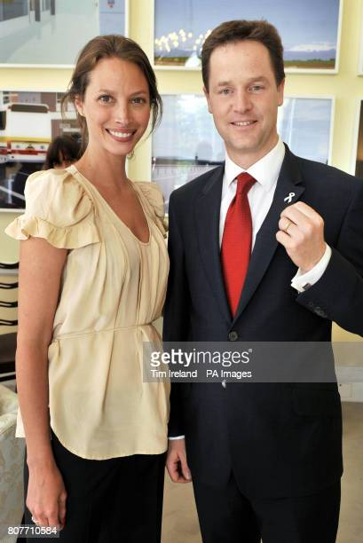 Deputy Prime Minister Nick Clegg shows his White Ribbon Alliance For Safe Motherhood pin badge as he meets with Christy Turlington in the Cabinet...