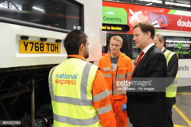 Deputy Prime Minister Nick Clegg talks to apprentices Harmanpreet Singh and Craig Perkins during a visit to National Express West Midlands Birmingham...