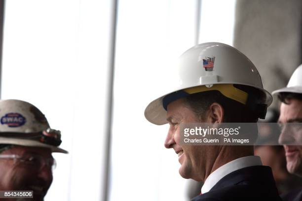 Deputy Prime Minister Nick Clegg talks to construction workers during a visit to the World Trade Center 9/11 Memorial and the new 1 World Trade...