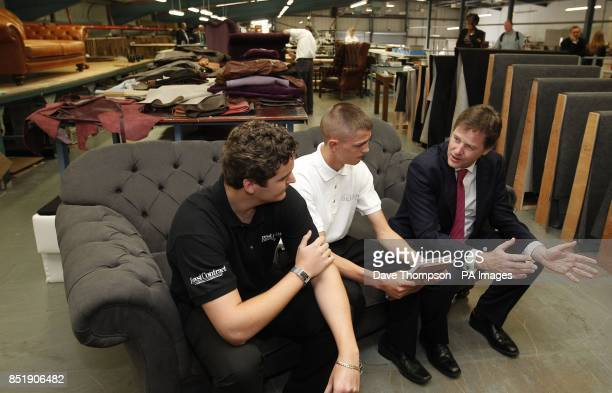 Deputy Prime Minister Nick Clegg talks to former apprentice Chris Allen left and this years apprentice Luke Whitehead centre during a visit to Forest...