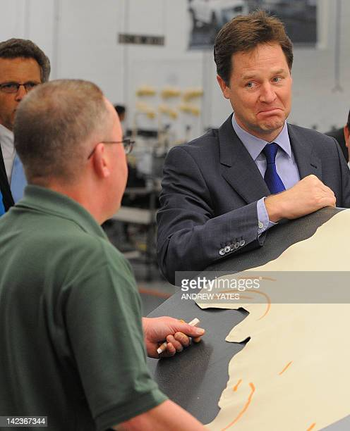 Deputy Prime Minister Nick Clegg talks with an upholsterer as he visits the Bentley Motors facility in Crewe northwest England on April 3 2012 Clegg...
