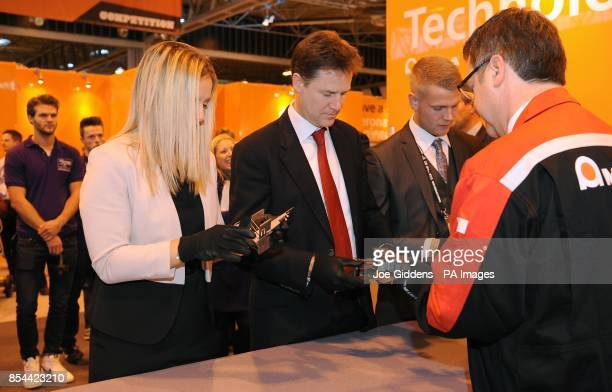 Deputy Prime Minister Nick Clegg tries his hand at sheet metal folding during The Skills Show at the NEC Birmingham Clegg took questions from more...