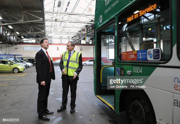 Deputy Prime Minister Nick Clegg with Managing Director Peter Coates during a visit to National Express West Midlands Birmingham Clegg was meeting...