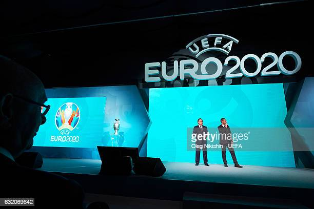 Deputy Prime Minister of the Russian Federation Vitaly Mutko and UEFA president Aleksander Ceferin speak on stage during the official EURO 2020 logo...