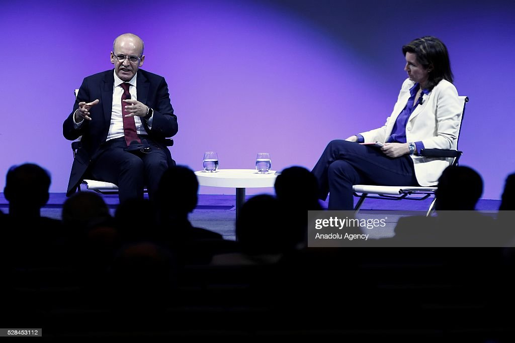 Deputy Prime Minister of Turkey Mehmet Simsek (L) gives a speech during BBVA's corporate seminar after he met with Spain's Bank Bilbao Vizcaya Argentaria's (BBVA) President Francisco Gonzalez (not seen) before in Madrid, Spain on May 5, 2016.