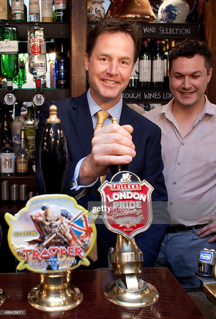 Deputy Prime Minster Nick Clegg pulls a pint at the Queens Head Pub during a brief visit on June 3, 2014 in Soho, London, England. The pair announced a new code of practice to help Pub landlords. (Photo by Ben Gurr - WPA Pool/Getty Images)Alternate crop of #495424367