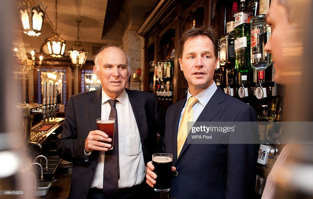 Deputy Prime Minster <a gi-track='captionPersonalityLinkClicked' href=/galleries/search?phrase=Nick+Clegg&family=editorial&specificpeople=579276 ng-click='$event.stopPropagation()'>Nick Clegg</a> shares a pint with Business Secretary <a gi-track='captionPersonalityLinkClicked' href=/galleries/search?phrase=Vince+Cable&family=editorial&specificpeople=4872939 ng-click='$event.stopPropagation()'>Vince Cable</a>, at the Queens Head Pub during a brief visit on June 3, 2014 in Soho, London, England. The pair announced a new code of practice to help Pub landlords.