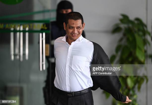 Deputy public prosecutor Muhammad Iskandar Ahmad leaves the Malaysian Chemistry Department in Petaling Jaya outside Kuala Lumpur on October 9 as part...
