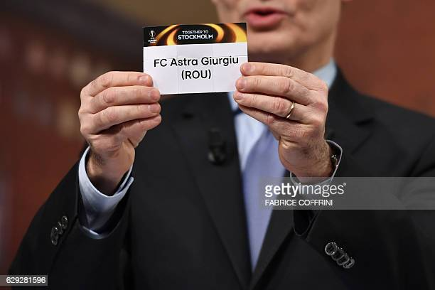 UEFA deputy secretary general Giorgio Marchetti holds the name of Astra Giurgiu during the draw for the round of 32 of the UEFA Europa League...