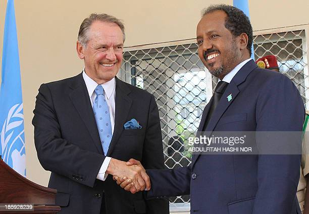 UN deputy secretary general Jan Elissson shakes hands with Somali president Hassan Sheikh Mahmud during a press conference at the presidential palace...