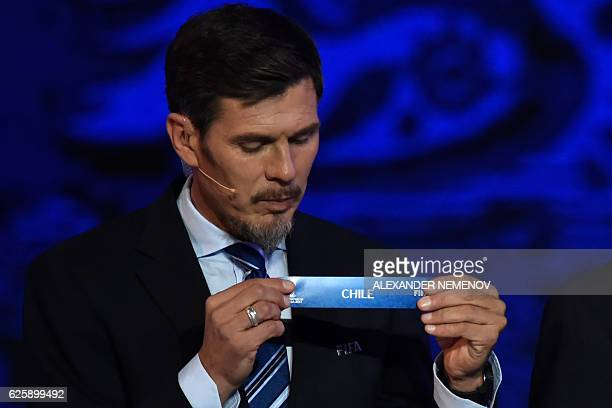 Deputy Secretary General Zvonimir Boban shows the name of Chile during the draw for the 2017 FIFA Confederations Cup at the tennis academy center in...