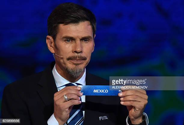 Deputy Secretary General Zvonimir Boban shows the name of Mexico during the draw for the 2017 FIFA Confederations Cup at the tennis academy center in...