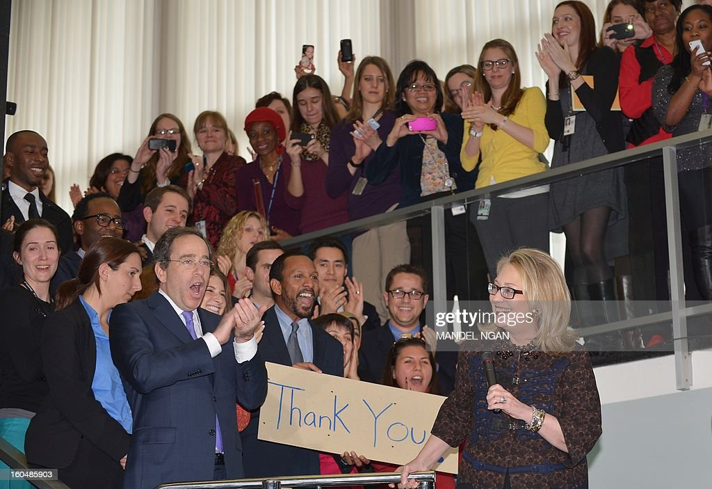 Deputy Secretary of State for Management and Resources Thomas Nides (L) cheers as outgoing US Secretary of State Hillary Clinton speaks to State Department employees on February 1, 2013 in Washington, DC. Clinton bid a final farewell to her staff Friday, but her last day was marred by a suicide bomber blew himself up at the US embassy in Ankara. AFP PHOTO/Mandel NGAN