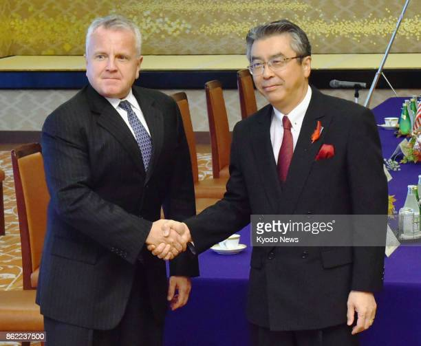 US Deputy Secretary of State John Sullivan and Japanese Vice Foreign Minister Shinsuke Sugiyama shake hands before their talks in Tokyo on Oct 17...