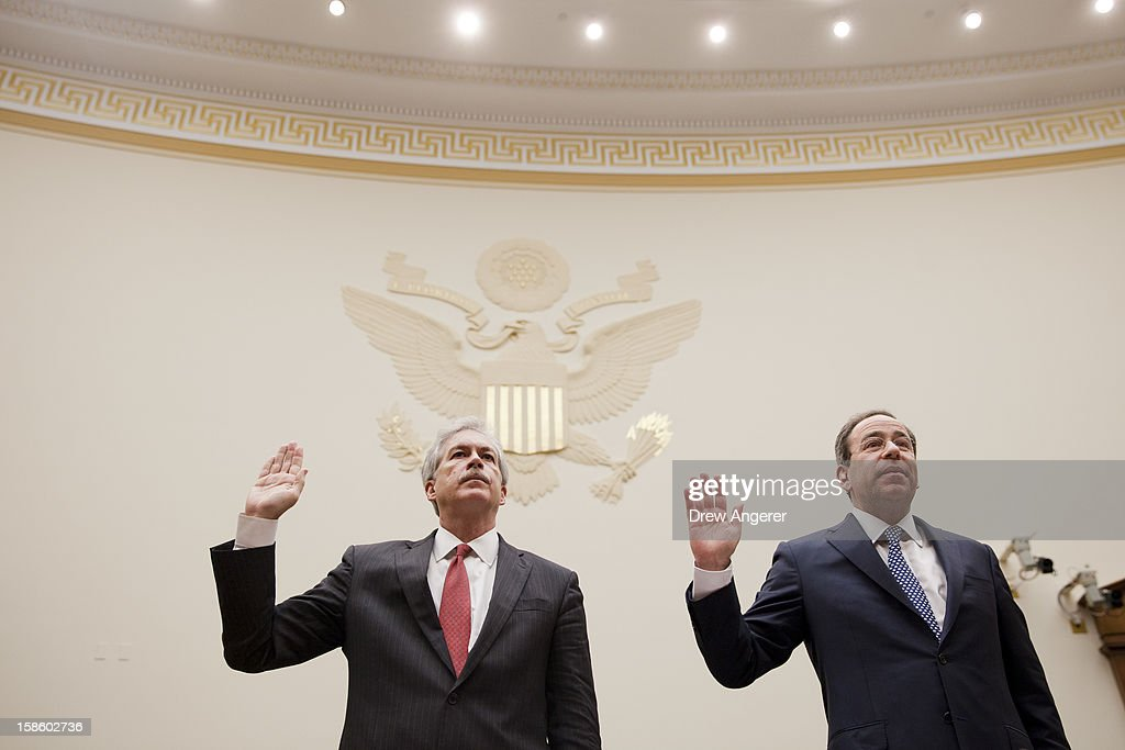 Deputy Secretary of State William Burns (L) and Deputy Secretary of State for Management and Resources Thomas Nides (R) are sworn in at the start of the House Foreign Affairs Committee on the September 11th attack in Benghazi against the U.S. consulate, on Capitol Hill, December 20, 2012 in Washington, DC. Secretary of State Hillary Clinton was scheduled to testify, but was unable to attend due to an illness.