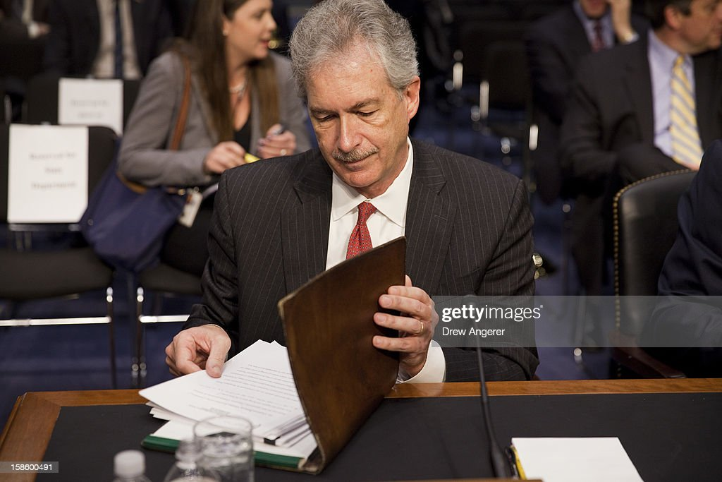 Deputy Secretary of State William Burns looks over documents before the start of the Senate Foreign Relations Committee hearing on the September 11th attacks on the U.S. Consulate in Benghazi, on Capitol Hill, December 20, 2012 in Washington, DC. Secretary of State Hillary Clinton had planned to testify at the hearing, but could not attend due to an illness.
