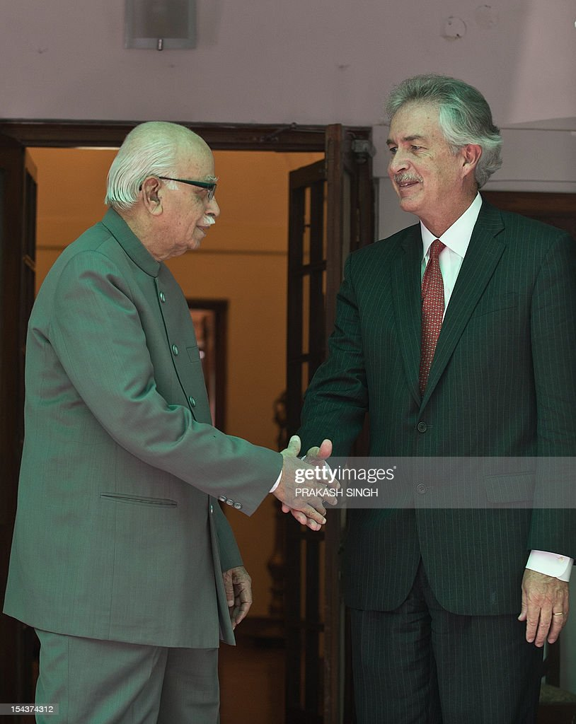 US Deputy Secretary of State William Burns (R) shakes hands with opposition Bhartiya Janata Party (BJP) senior leader L.K. Advani prior to a meeting in New Delhi on October 19, 2012. Burns is in India to hold talks on a wide range of bilateral, regional and global issues with top officials of the country. AFP PHOTO/ Prakash SINGH