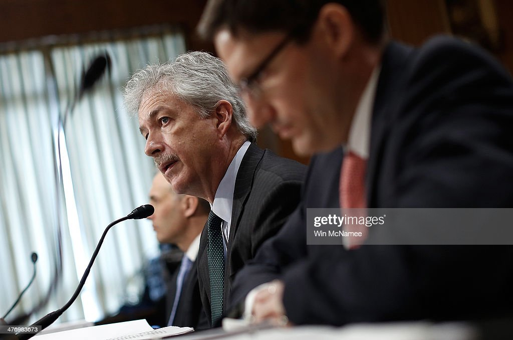 Deputy Secretary of State William Burns (C) testifies before the Senate Foreign Relations Committee with Assistant Defense Secretary for International Security Affairs Derek Chollet (R) and Matthew Olsen (L), director of the National Counterterrorism Center, March 6, 2014 in Washington, DC. The committee heard testimony on the situations in Ukraine and Syria.