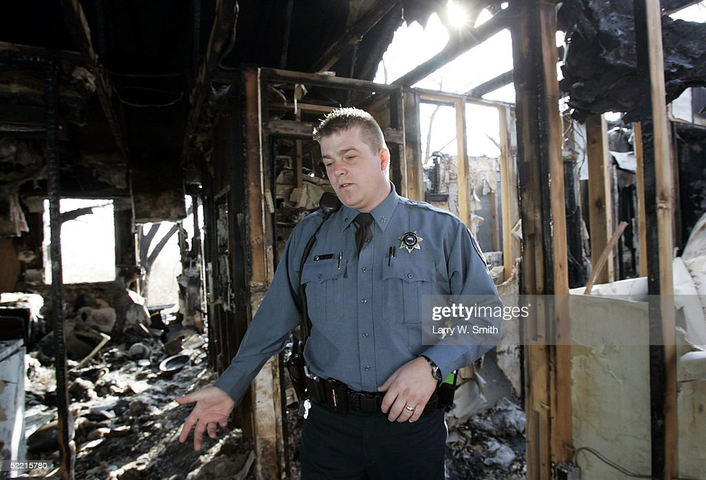 Deputy Sheriff Kirk Ives looks for signs of leftover methamphetamine use inside a burned out house on Febuary 18, 2005 while he patrols the rural areas near Pratt, Kansas. The Pratt County sheriff office has over 700 square acres of rural land to patrol on a daily basis looking for any kind of methamphetamine substances such as trash or labs.
