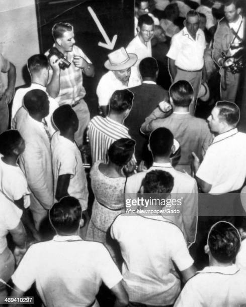 Deputy sheriff searching the crowd gathered in the courtroom at the start of the trial of Roy Bryant and John Milan for murdering Emmett Till in 1955...