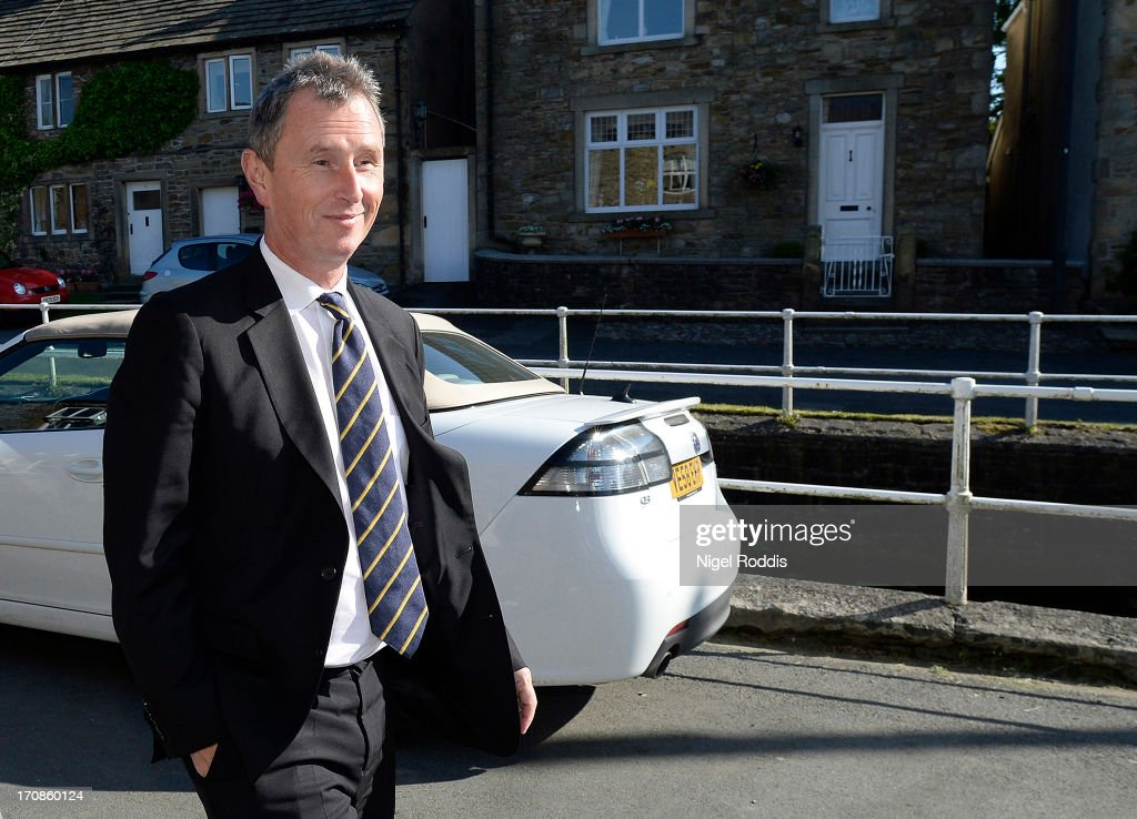 Deputy Speaker <a gi-track='captionPersonalityLinkClicked' href=/galleries/search?phrase=Nigel+Evans&family=editorial&specificpeople=2486752 ng-click='$event.stopPropagation()'>Nigel Evans</a> returns to his home after being arrested on suspicion of three further offences of indecent assault, on June 19, 2013 in Pendleton, England. The MP for Ribble Valley answered bail at Preston police station and was informed that he would face further allegations of indecent assault, in addition to charges from May 2013.
