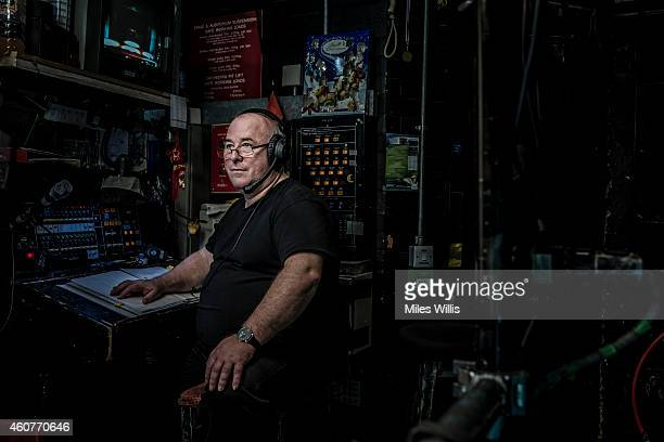 Deputy Stage Manager John Blundon poses at his desk for a portrait at Hackney Empire on December 17 2014 in London England Hackney Empire is...