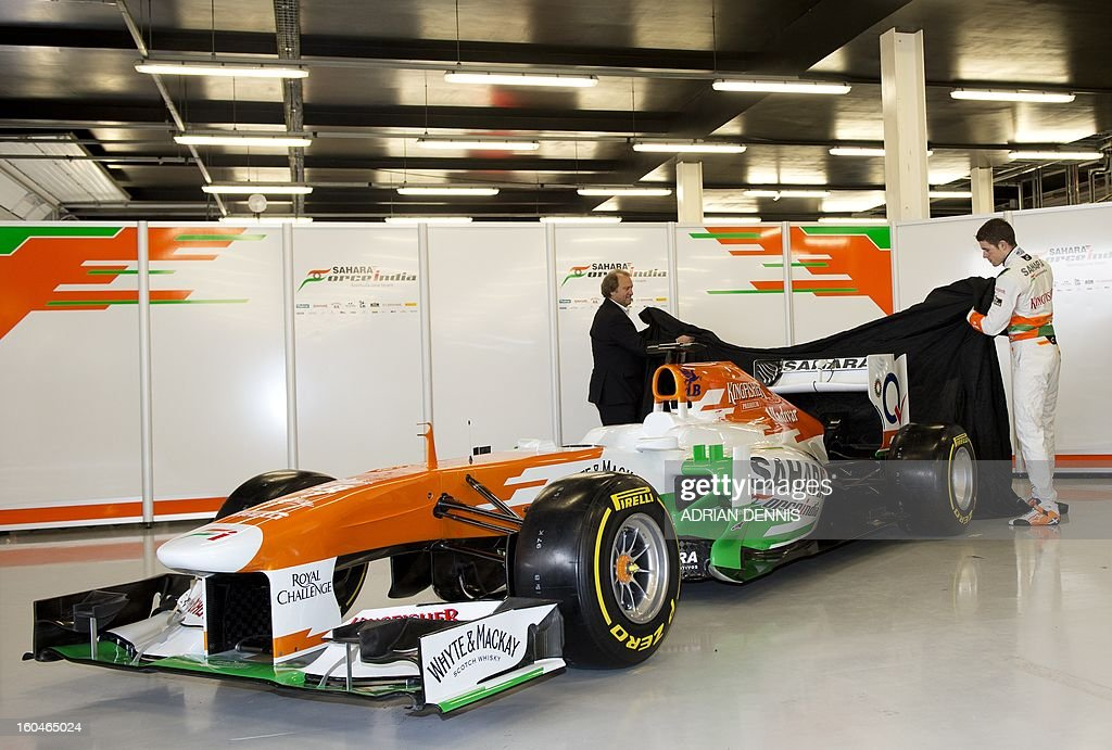 Deputy Team Principal Bob Fernley (L) and British driver Paul Di Resta (R) unveil the Sahara Force India VJM06 Formula 1 racing car during the launch at Silverstone race circuit near Northampton on Febuary 1, 2013. Force India have yet to announce their second driver to join British driver Paul Di Resta.