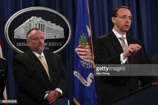 Deputy US Attorney General Rod Rosenstein speaks as Acting DEA Administrator Robert Patterson listens during a news conference October 17 2017 at the...