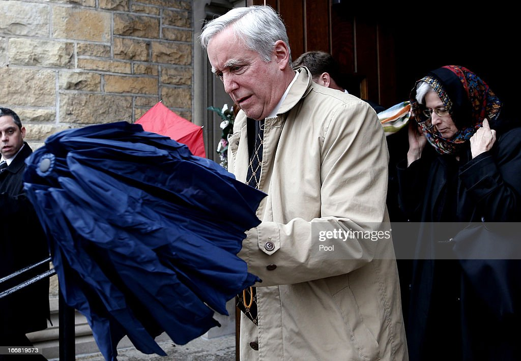 Deputy US Special Envoy for Afghanistan and Pakistan David Pearce departs St Luke Catholic Church after attending the funeral Mass for US diplomat...