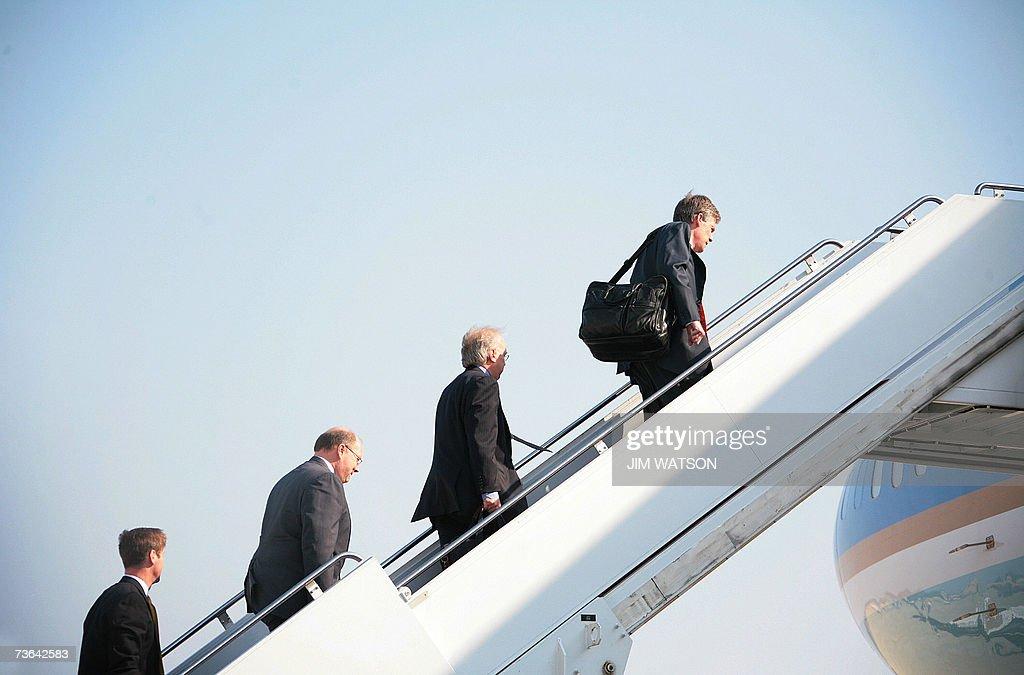 Deputy White House Chief of Staff Joe Hagin top political advisor Karl Rove and White House Spokesman Tony Snow board Air Force One with US President...