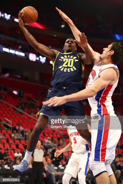 DeQuan Jones of the Indiana Pacers tries to get a first half shot off past Boban Marjanovic of the Detroit Pistons during a pre season game at Little...
