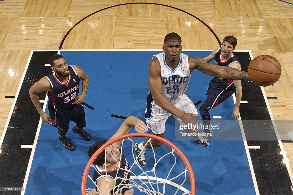 <a gi-track='captionPersonalityLinkClicked' href=/galleries/search?phrase=DeQuan+Jones&family=editorial&specificpeople=5626127 ng-click='$event.stopPropagation()'>DeQuan Jones</a> #20 of the Orlando Magic drives to the basket against the Atlanta Hawks on February 13, 2013 at Amway Center in Orlando, Florida.
