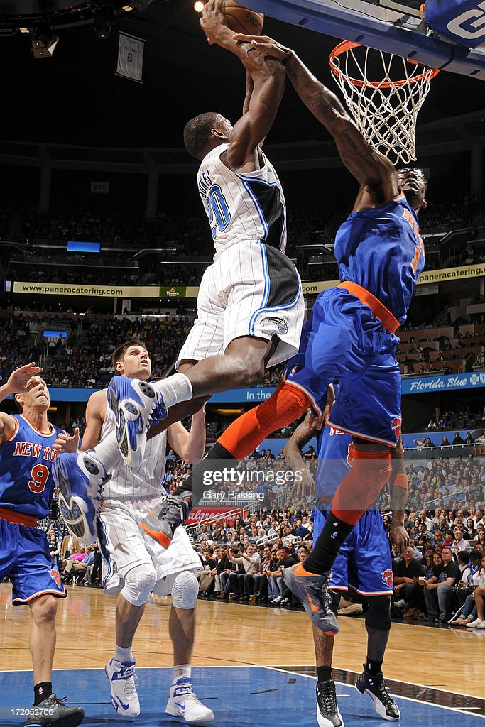 <a gi-track='captionPersonalityLinkClicked' href=/galleries/search?phrase=DeQuan+Jones&family=editorial&specificpeople=5626127 ng-click='$event.stopPropagation()'>DeQuan Jones</a> #20 of the Orlando Magic dunks over <a gi-track='captionPersonalityLinkClicked' href=/galleries/search?phrase=Amar%27e+Stoudemire&family=editorial&specificpeople=201492 ng-click='$event.stopPropagation()'>Amar'e Stoudemire</a> #1 of the New York Knicks during the game on January 5, 2013 at Amway Center in Orlando, Florida.