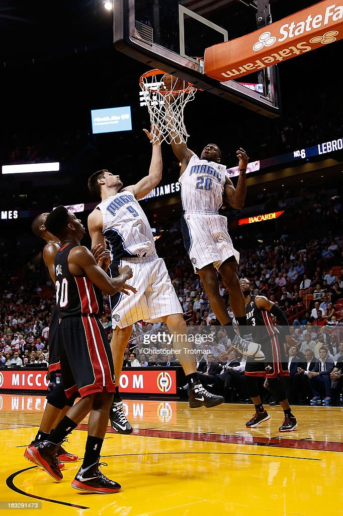 <a gi-track='captionPersonalityLinkClicked' href=/galleries/search?phrase=DeQuan+Jones&family=editorial&specificpeople=5626127 ng-click='$event.stopPropagation()'>DeQuan Jones</a> #20 of the Orlando Magic dunks the ball as <a gi-track='captionPersonalityLinkClicked' href=/galleries/search?phrase=Norris+Cole&family=editorial&specificpeople=5770147 ng-click='$event.stopPropagation()'>Norris Cole</a> #30 of the Miami Heat looks on at American Airlines Arena on March 6, 2013 in Miami, Florida.