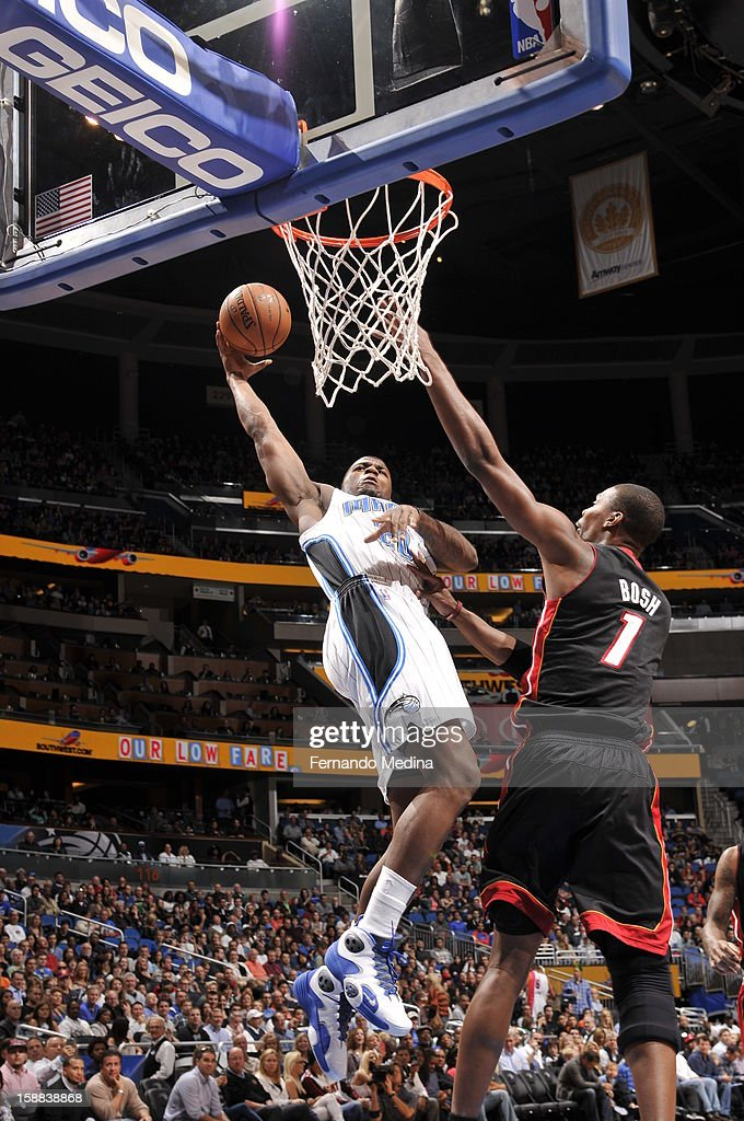 DeQuan Jones #20 of the Orlando Magic goes up for the shot against Chris Bosh #1 the Miami Heat during the game on December 31, 2012 at Amway Center in Orlando, Florida.